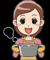 炊き立てのご飯を持つ女性